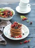 Breakfast set. Buckwheat pancakes with fresh Royalty Free Stock Photography