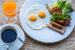 Breakfast set. With coffee fried eggs, sausage, ham, potato and orange juice Royalty Free Stock Photography