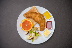 Breakfast set with Croissant, orange, fruits and jam Stock Image