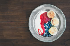 Breakfast set: curd pancakes with yogurt, fresh blueberry and ra Royalty Free Stock Photos