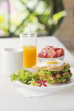 Breakfast set with egg sandwich and fruit salad Stock Photography