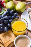 Breakfast set with fruits and orange juice Stock Image