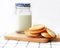 Breakfast set, glass of milk, snack on wooden plate Stock Photo