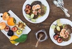 Breakfast set. Homemade zucchini pancakes with fresh plum, tangerine, grapes Royalty Free Stock Image