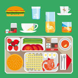 Breakfast set. A set of objects and products for breakfast. It includes tea, coffee, sandwiches, juice, eggs, seafood and more. Background green Royalty Free Stock Image