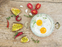 Breakfast set with roasted eggs, bread toasts with pesto souce, Stock Photo
