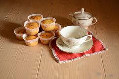Breakfast set with some muffins. Typical italian breakfast set with cup of milk and cup of sugar and muffins Stock Images