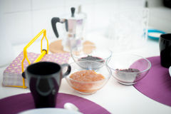 Breakfast set table close up, focus on marmalade bowls Royalty Free Stock Images