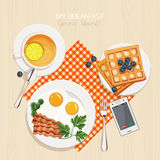 Breakfast set with tea. Lemon, belgian waffles, bacon and eggs, parsley, green beans. Top view. Mealtime Stock Photography