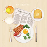 Breakfast set with tea and lemon. Breakfast set with tea, lemon, milk, bacon and eggs, parsley, toast, butter and newspaper. Top view Stock Image