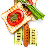 Breakfast set of toast bread, tomato, sausage and herbs, isolate Royalty Free Stock Photo