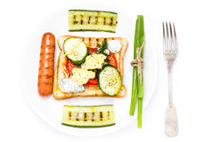 Breakfast set of toast bread, tomato, sausage and herbs, isolate Stock Photography
