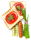 Breakfast set of toast bread, tomato, sausage and herbs, isolate Stock Photo