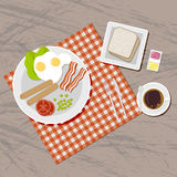 Breakfast set. Top view. Breakfast set. Blanket on wooden table. including sausages, fried eggs, becon, tomato, pea, salad, toasts bread, jam and butter, coffee Stock Image