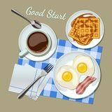 Breakfast set top view. Coffee, fried egg with bacon, waffles Royalty Free Stock Image