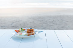 Breakfast set on white table. Royalty Free Stock Photography