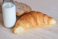 Breakfast set with whole wheat bread milk and croissant Royalty Free Stock Images