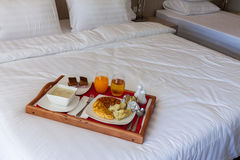 Breakfast set  in wooden tray serving on bed Royalty Free Stock Photos