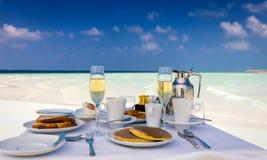 Breakfast setting on a beach Stock Photos