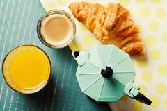 Breakfast setting with coffee and orange juice. Breakfast setting with coffee, croissant and orange juice, top view Stock Photo