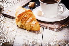 Breakfast setting with coffee and fresh croissant Stock Images