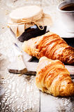 Breakfast setting with coffee, fresh croissants and jam Stock Photos