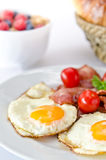 Breakfast setting with fried eggs. royalty free stock photography