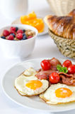 Breakfast setting with fried eggs. Stock Photos