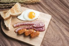 Breakfast setting with sauaage and bacon omelette on the table w Stock Images