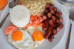 Breakfast, Simple Breakfast, Asian Breakfast, Philippine Breakfast, Traditional Philippine Breakfast. Simple Asian Breakfast with Rice, Egg, Sausage, Juice and Stock Image