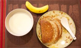 Breakfast. Simple breakfast milk bread banana Royalty Free Stock Images