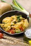 Breakfast Skillet 001. A hearty start to your day with a breakfast skillet of potatoes, eggs, fresh vegetables with melted cheese on top Stock Photos