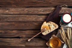Breakfast. A slice of bread, honey, milk and wheat ears Stock Image