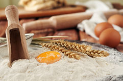 Breakfast. A slice of bread, honey, milk and wheat ears Royalty Free Stock Photography