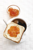 Breakfast, Slice of Toast with butter and orange jam Stock Photography
