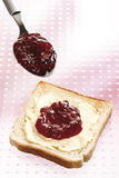 Breakfast, Slice of Toast with butter and raspberry jam Stock Photos
