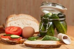 Breakfast. Sliced bread on a wooden board Royalty Free Stock Image