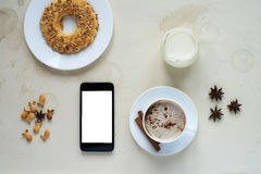 Breakfast with a smartphone Royalty Free Stock Photo