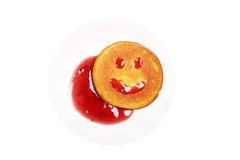 Breakfast with a smiling biscuit on the plate Stock Photography