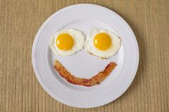 Breakfast Smiling Emoji. Made of eggs sunny side up, and bacon stock images