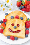 Breakfast with a smiling toast and fresh berries Stock Image