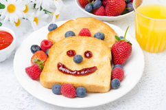 Breakfast with a smiling toast, fresh berries, jam Royalty Free Stock Image