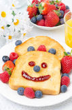 Breakfast with a smiling toast, fresh berries and orange juice Royalty Free Stock Images