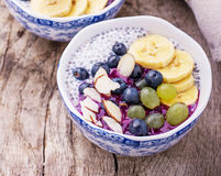 Breakfast smoothie bowl with fruits and granola stock photos