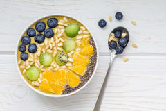 Breakfast smoothie bowl with matcha green tea, kiwi and banana Stock Photos