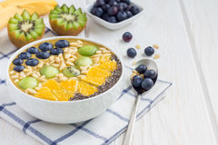 Breakfast smoothie bowl topped with berries, fruits, nuts and seeds Royalty Free Stock Images