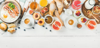 Breakfast snacks and drinks set on white wooden background Royalty Free Stock Photos