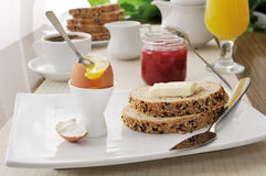 Breakfast with soft-boiled egg and slices of oatmeal bread Royalty Free Stock Images