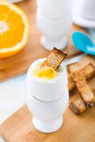 Breakfast with soft boiled eggs and toast soldiers Stock Photography