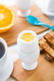 Breakfast with soft boiled eggs and toast soldiers Stock Photo